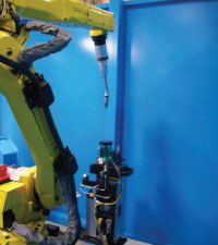 Robotic welding cell.
